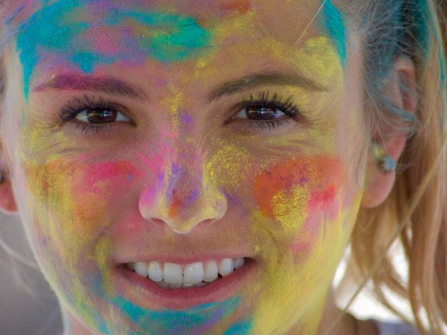 NOMINATED A beautiful woman with colors on her face from a Holi color festival